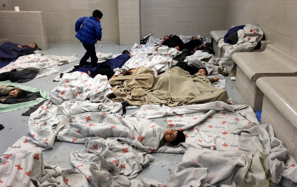 2_7_0_child-detainees-sleep-in-a-holding-cell-at-a-us-customs-and-border-protection-processing-facility-in-brownsville-texas