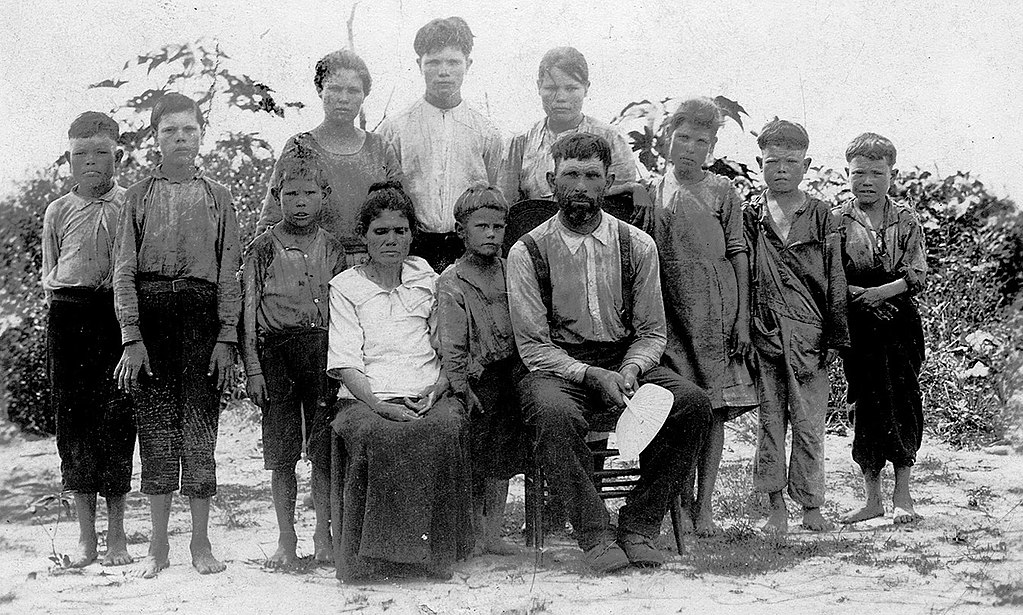 """This poor white family from Alabama was presented in 1913 as """"celebrities"""" because they had escaped the debilitating effects of hookworm disease, which, along with pellagra was endemic among Southern """"white trash"""" due to poor sanitation and the phenomenon of """"clay eating"""" (geophagia)."""