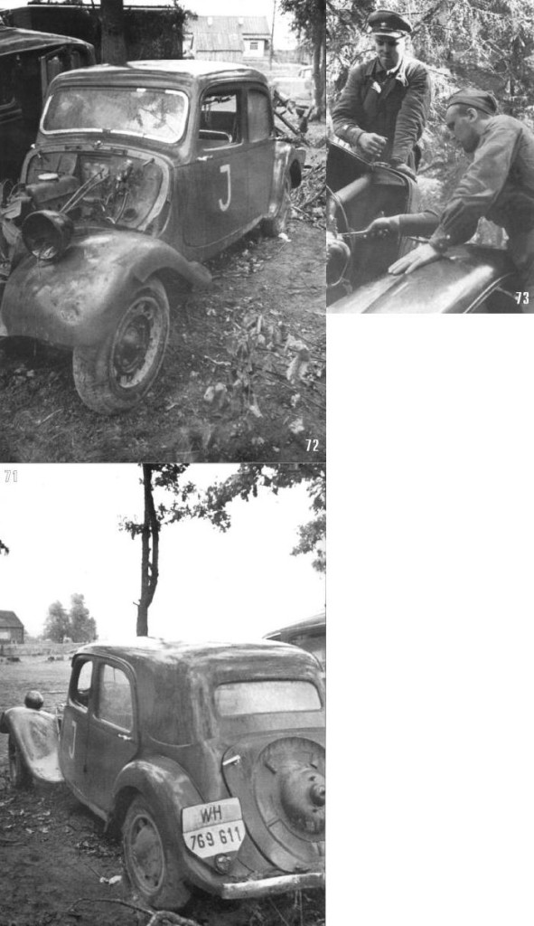 Советские солдаты пытаются починить машину, брошенную немцами при отступлении. Брянский фронт, сентябрь.